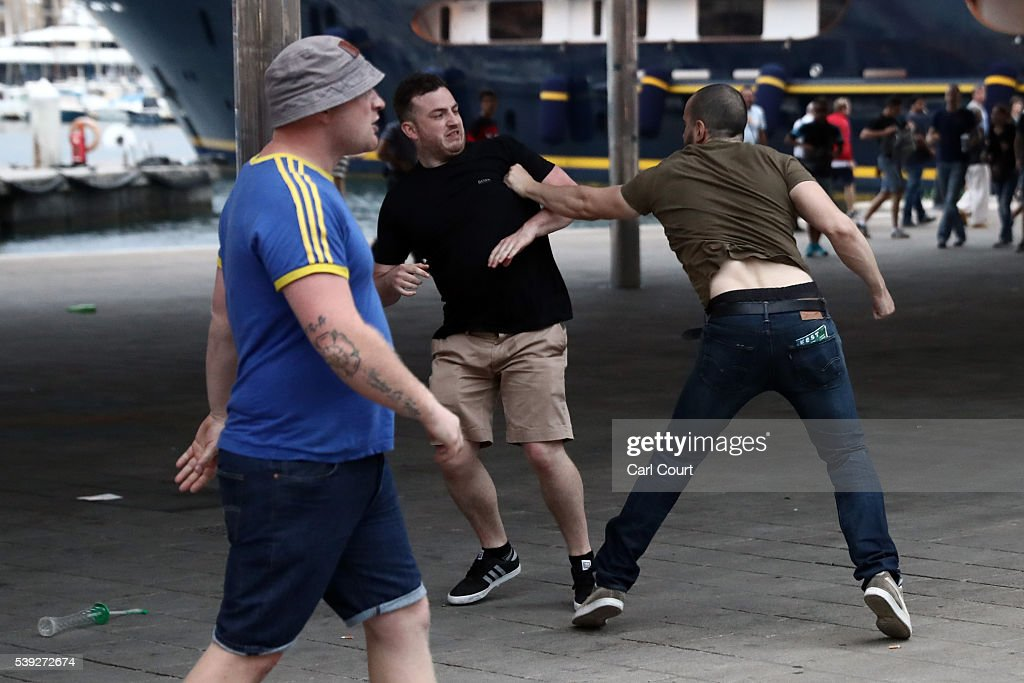 An England football fan fights with a local person as England fans clash with police in Marseille on June 10, 2016 in Marseille, France. Football fans from around Europe have descended on France for the UEFA Euro 2016 football tournament.