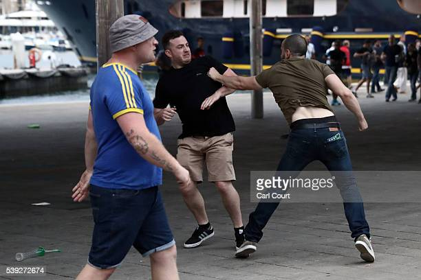 An England football fan fights with a local person as England fans clash with police in Marseille on June 10 2016 in Marseille France Football fans...