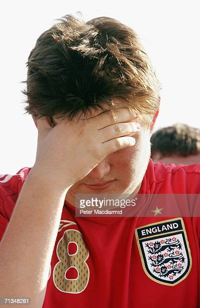 An England football fan holds his hand to his face at the Fan Fest on July 1 2006 in Gelsenkirchen Germany England are playing Portugal in the FIFA...