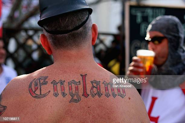 An England football supporter shows his tatoo's in a bar on the Waterfront on June 18 2010 in Cape Town South Africa Cape Town hosts the match...