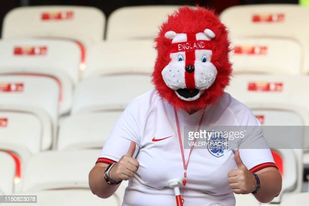 An England supporter poses prior to the France 2019 Women's World Cup Group D football match between Japan and England, on June 19 at the Nice...