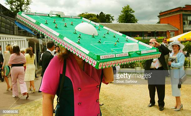 An England supporter wears an extravagant hat in the shape of a mini football pitch during Ladies Day on the third day of Royal Ascot at the Ascot...