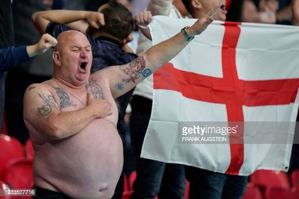 An England's supporter cheers and gestures before the start of the UEFA EURO 2020 Group D football match between England and Scotland at Wembley...