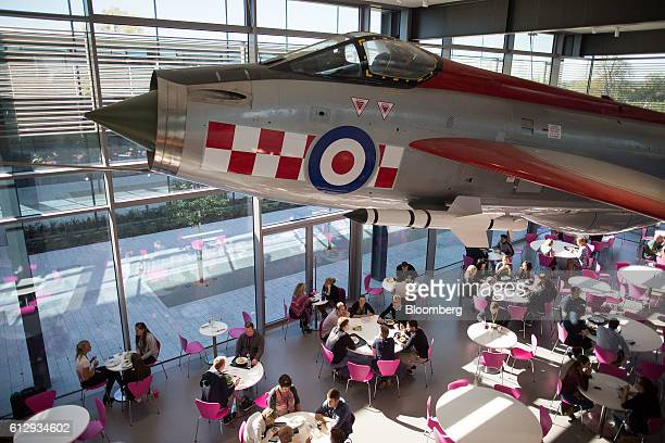 An English Electric Lightning fighter jet hangs above workers as they sit at tables during lunch in the lightning cafe at the Dyson Ltd campus in...