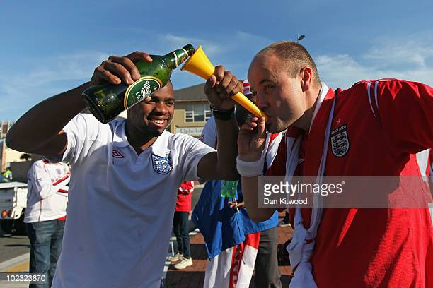 An English fan drinks beer through a vuvuzela outside Nelson Mandela Bay Stadium on June 23 2010 in Port Elizabeth South Africa England play Slovenia...