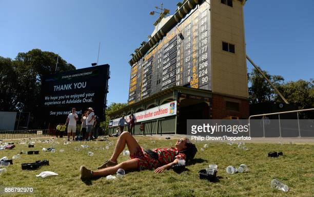 An English fan stays on to sunbathe after the fifth day of the second Ashes cricket test match between Australia and England at the Adelaide Oval on...