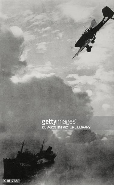 An English merchant ship being attacked by a Junkers Ju 87 dive bomber on the English Channel, World War II, from L'Illustrazione Italiana, Year...