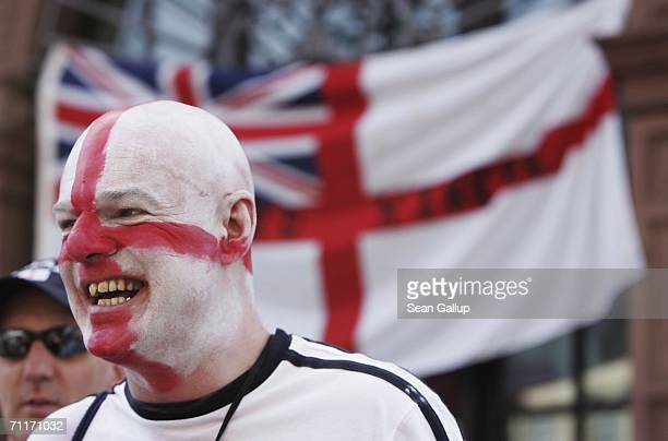 An English soccer fan painted in the colors of the St George flag walks through the city center June 10 2006 in Frankfurt am Main Germany England was...