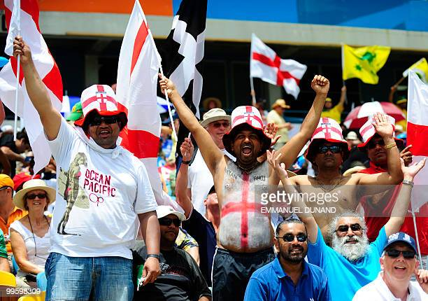An English supporters cheer during the Men's ICC World Twenty20 final match between Australia and England at the Kensington Oval Cricket Ground in...