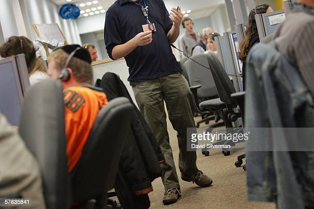 An Englishspeaking operator paces around his desk as he works through the night to convince an American Online member not to cancel their AOL account...