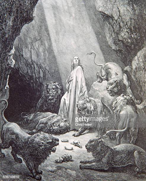 An engraving by the French printmaker Gustave Dore of Daniel in the Den of the Lions a scene from Dore's Bible
