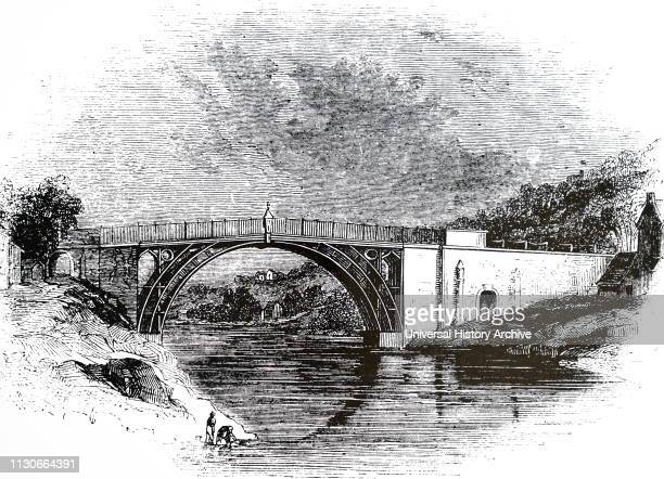 An engraving depicting Abraham Darby III's iron bridge in Coalbrookdale Shropshire Dated 19th century