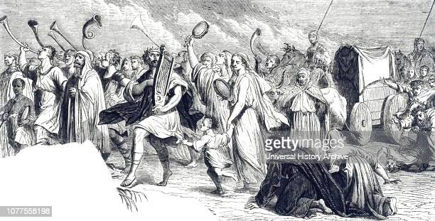 An engraving depicting King David and all the House of Israel playing and dancing as the Ark of the Covenant is brought into the city Dated 19th...