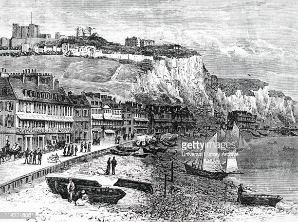 An engraving depicting terraces of houses on the seafront with Dover castle in the background Dated 19th century