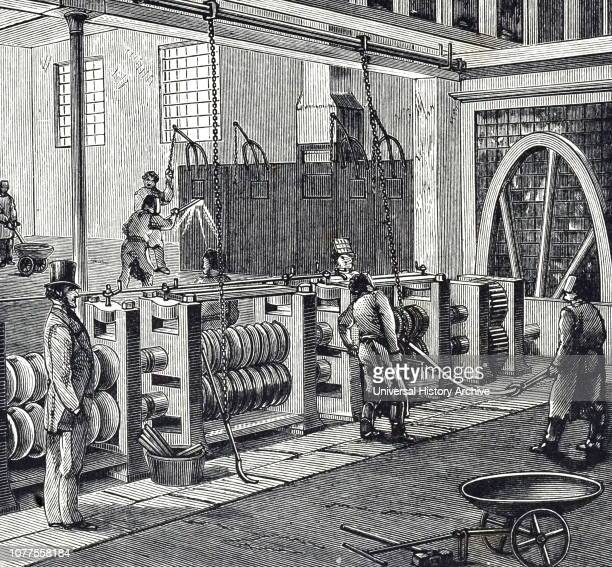 An engraving depicting the process of making wrought iron rolling blooms into bars Dowlais Ironworks an ironworks and steelworks located at Dowlais...