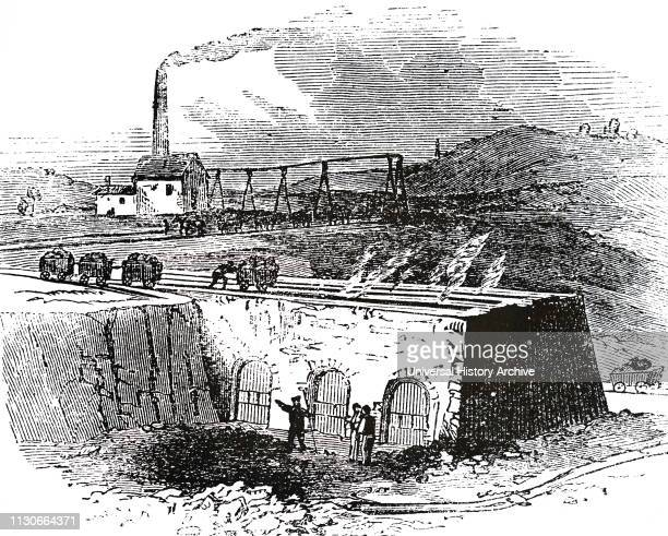An engraving depicting the roasting of iron ore in Coalbrookdale Shropshire Dated 19th century