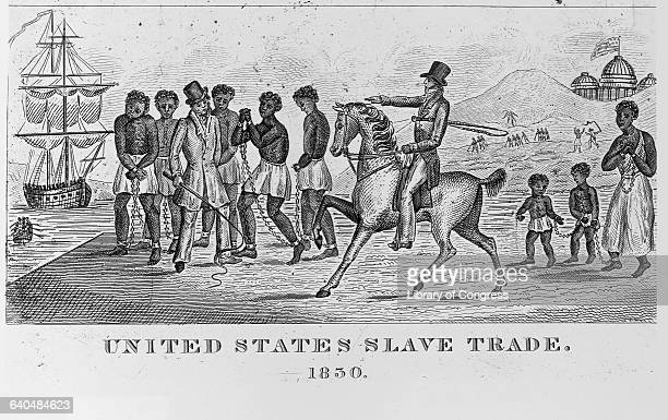 An engraving entitled United States Slave Trade done in 1830 depicts a man on horseback as he points toward his choice of slaves for sale near a...