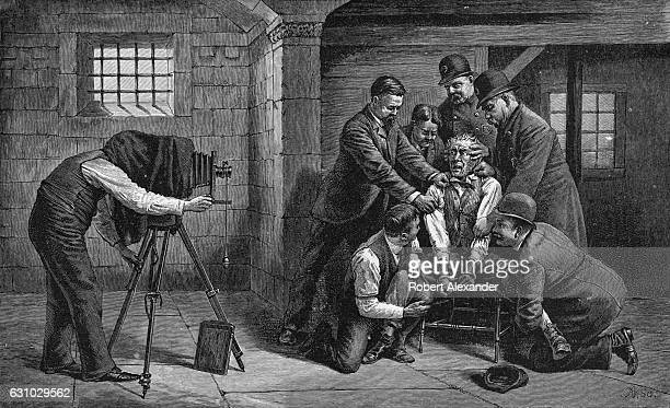 An engraving from the book 'Darkness and Daylight or Lights and Shadows of New York Life' is titled 'An Unwilling Subject Photographing a Prisoner...
