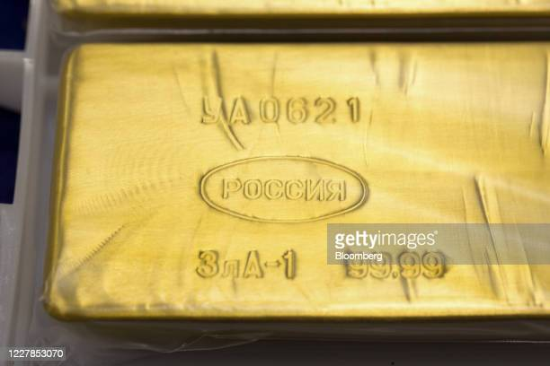An engraving of 99.99 identifies the purity displayed on a 12.5 kilogram gold ingot at the Uralelectromed Copper Refinery, operated by Ural Mining...