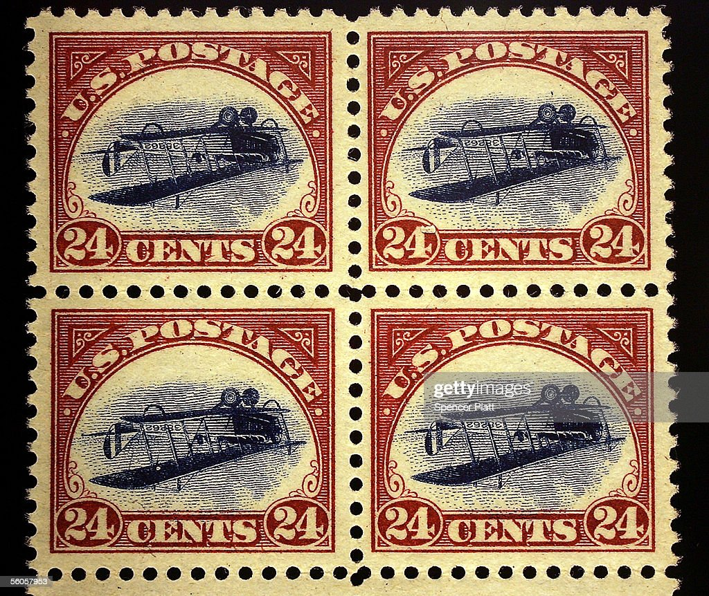 An enlarged replica of a block of four rare United States airmail