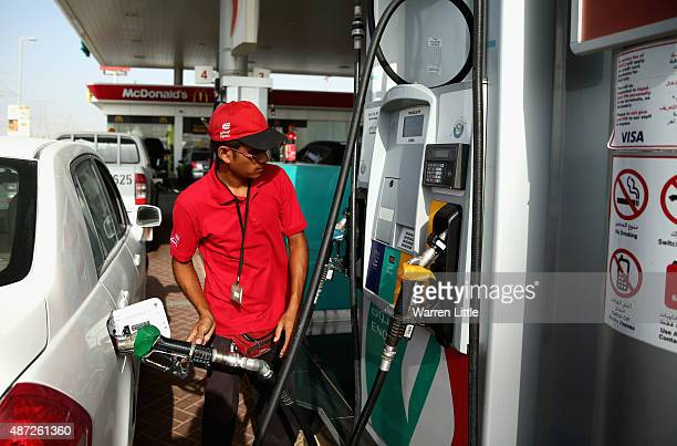 An Enoc petrol pump attendant is pictured on September 6 in Dubai United Arab Emirates Motorists will have to pay on average more than 20 percent...
