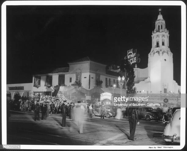 An enormous crowd gathered around the Fox Carthay Circle Theatre during the premiere of Los Angeles California early to mid twentieth century