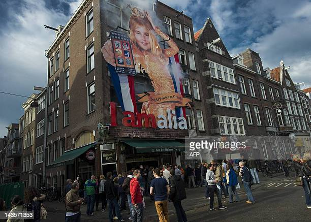 An enormous picture of Princess Amalia the oldest daughter of Prince WillemAlexander and Princess Maxima hangs on the facade of a cafe in Amsterdam a...