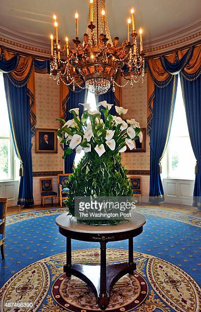 An enormous pineapple arrangement made from hosta and lillies by White House Florist Laura Dowling as she prepares the floral arrangements for the...