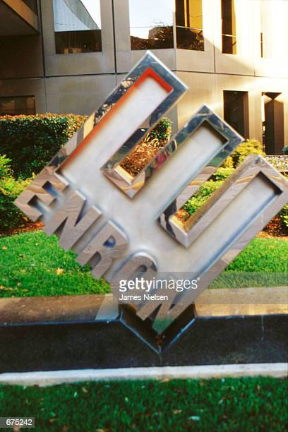 An Enron sign stands in front of the company's headquesters December 32001 in Houston Texas Enron filed for Chapter 11 protection and sued rival...