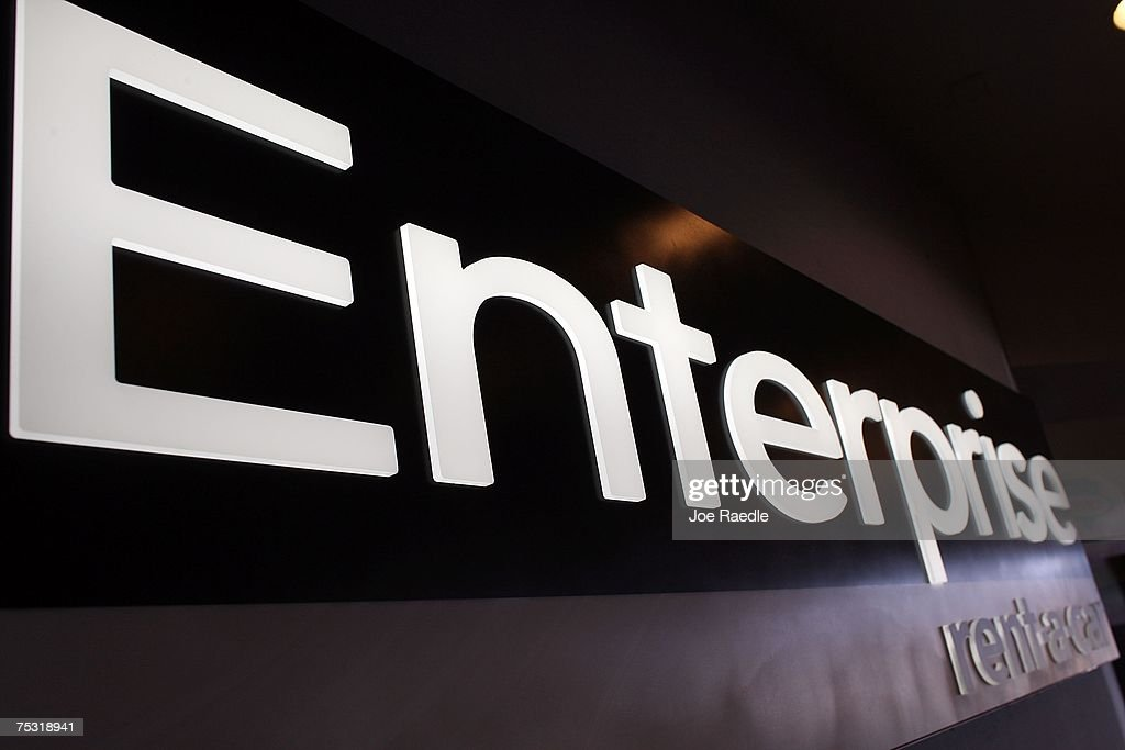 An Enterprise rent-a-car sign is seen at the Fort Lauderdale/Hollywood International airport July 10, 2007 in Fort Lauderdale, Florida. Pending regulatory approval, expected in the next month, Enterprise will buy National and Alamo rental car companies. Enterprise would make an instant jump from about 8% of the airport car rental market market to more than 27% just behind Hertz's 28.5%.