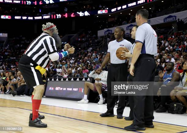 An entertainer consults the referees during week two of the BIG3 three on three basketball league at Spectrum Center on June 29, 2019 in Charlotte,...