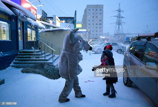 An entertainer dressed as a giant mouse entertains children at the Krestyansky open air market in Yakutsk Sakha Republic Russia on Wednesday Feb 17...