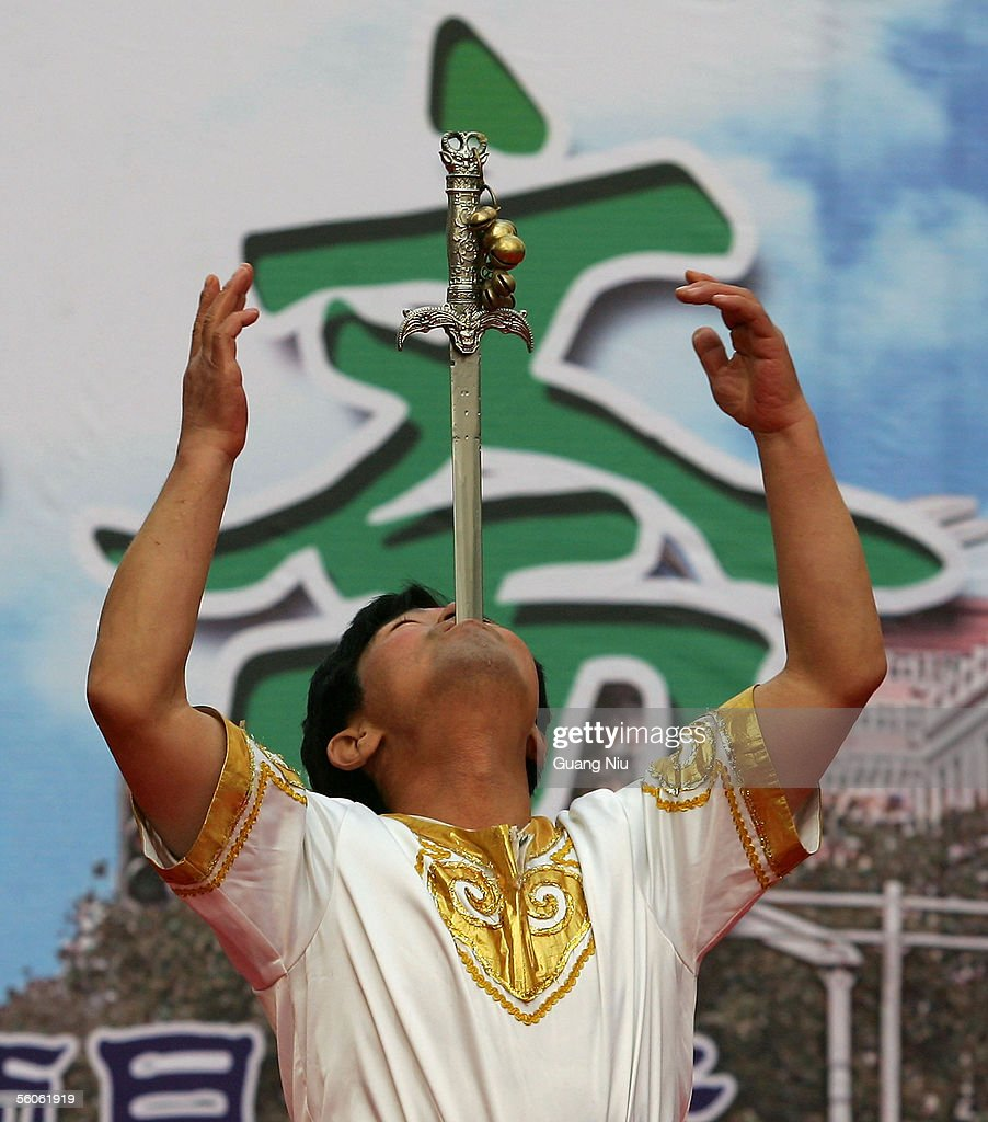 An entertainer performs at the Festival of Fast-Breaking after the Ramadan month in the Niujie Mosque on November 3, 2005 in Beijing, China. The Niujie Mosque is the largest mosque in China's capital and dates back to the 10th century and has been closed for the past six months for renovations and expansion.