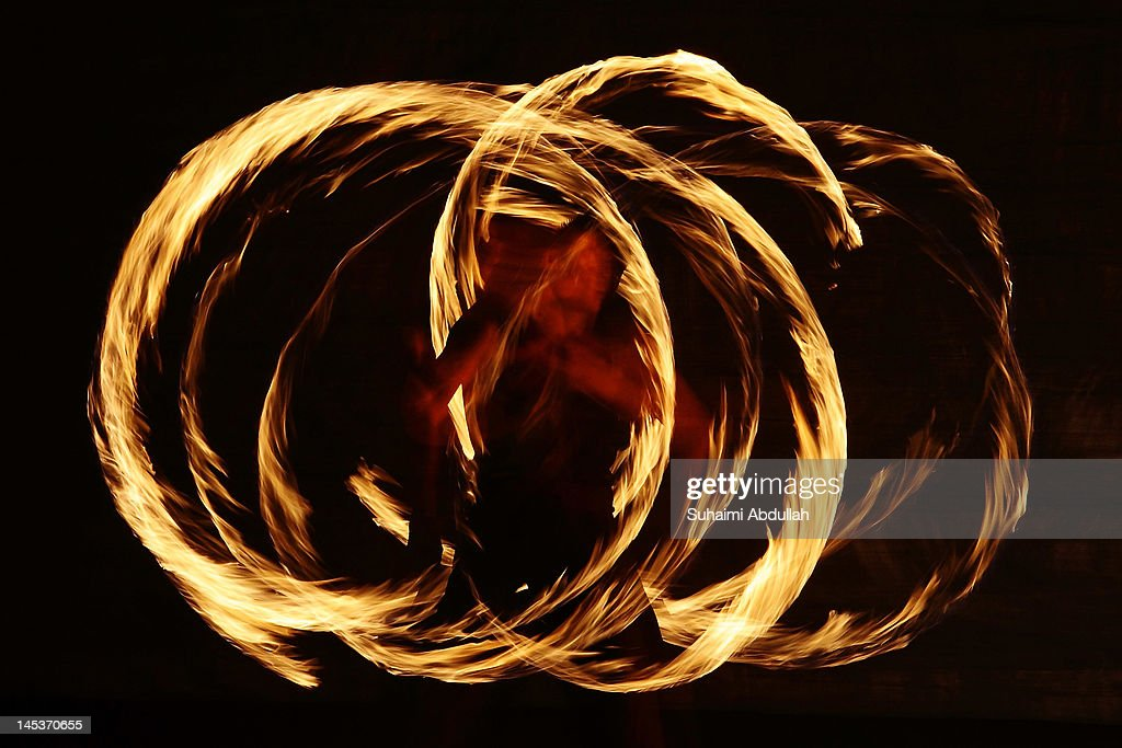 An entertainer performs on stage during the Bonfire festival at the Kallang Community Centre on May 26, 2012 in Singapore. Held annually since 2006, the Bonfire festival showcases electrifying acts of fire spinning and mesmerizing glow show, amongst others.