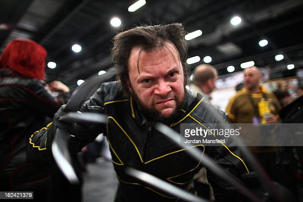 An enthusiast dressed as Wolverine poses for a photo at the London Super Comic Convention at the ExCeL Centre on February 23 2013 in London England...