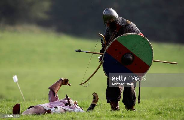 An enthusiast pretends to be slain during a reenactment of the 1066 AD Battle of Hastings on October 9 2010 in Battle near Hastings in the United...