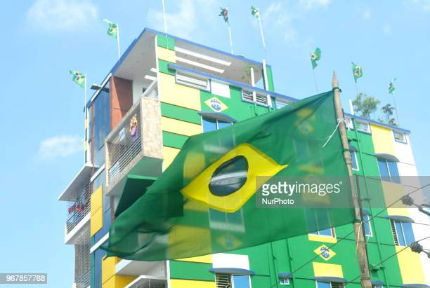 An enthusiast supporter of Brazilian football team decorates his home at Narayanganj of Bangladesh with Brazilian national flag ahead of the World...