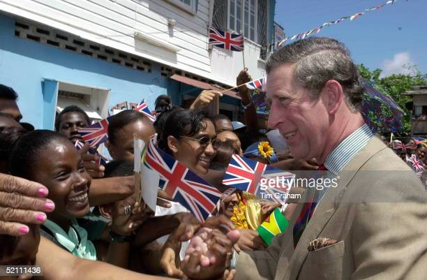 An Enthusiastic Crowd Greet Prince Charles During His Visit To See The Improvements Being Made At Albouystown A Slum Area Outside Georgetown The...