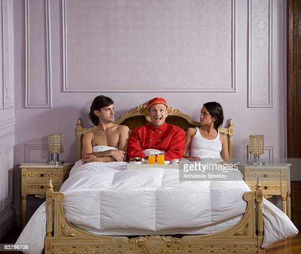 An enthusiastic valet serve breakfast in bed.