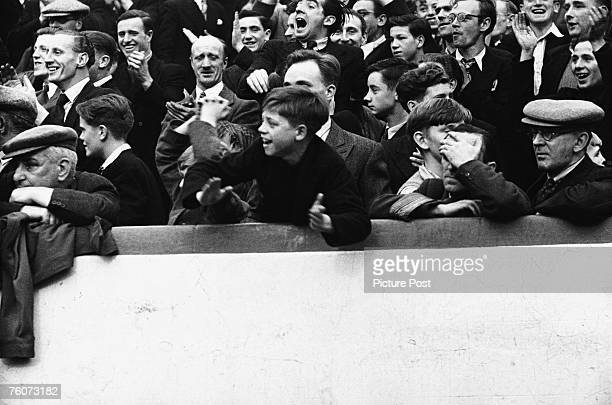 An enthusiastic young supporter at the Rangers vs Celtic Old Firm match Ibrox 15th October 1949 Original Publication Picture Post 4894 Glasgow's...