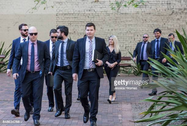 An entourage of mostly AFP representatives arrive at Sydney Central Local Court for the hearing of Michael and Fadi Ibrahim, Mustapha Dib and Koder...