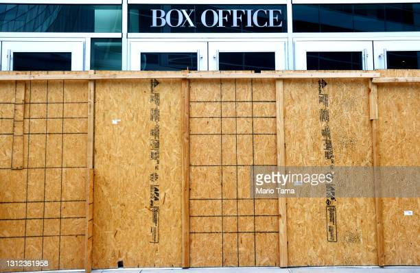 An entrance is boarded up at the shuttered ArcLight Hollywood movie theater, home of the famed Cinerama Dome, on April 13, 2021 in Los Angeles,...