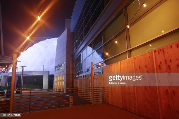 An entrance is boarded up next to the famed Cinerama Dome at the shuttered ArcLight Hollywood movie theater on April 13, 2021 in Los Angeles,...