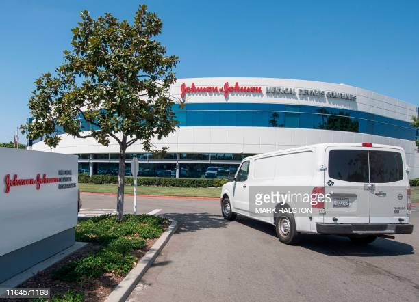An entrance to a building at the Johnson & Johnson campus in Irvine, California on August 28, 2019. - The US pharmaceutical industry faces tens of...