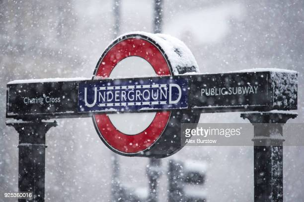 An entrance to Charing Cross Underground Station is pictured as snow falls in Trafalgar Square on February 28 2018 in London United Kingdom Freezing...