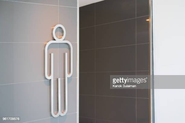 An entrance to the male toilet