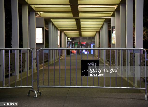 An entrance to The Mirage Hotel Casino is blocked off as parts of the Las Vegas Strip go dark as a result of the statewide shutdown due to the...