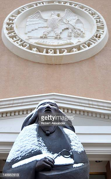 An entrance to the New Mexico State Capitol in Santa Fe, known as the Roundhouse, features a bronze sculpture by Allan Houser. The structure is the...
