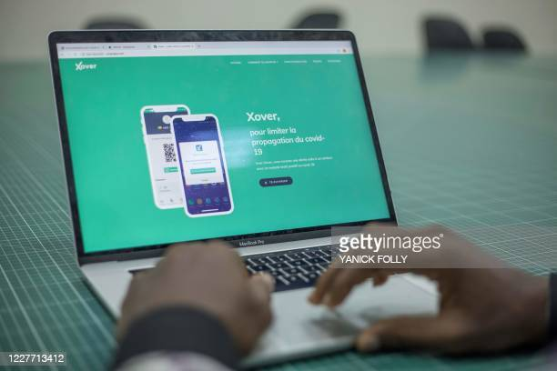 An entrepreneur presents the interface of the Xover application at the Sèmè-One building, an incubator for Beninese start-ups, in Cotonou on July 8,...