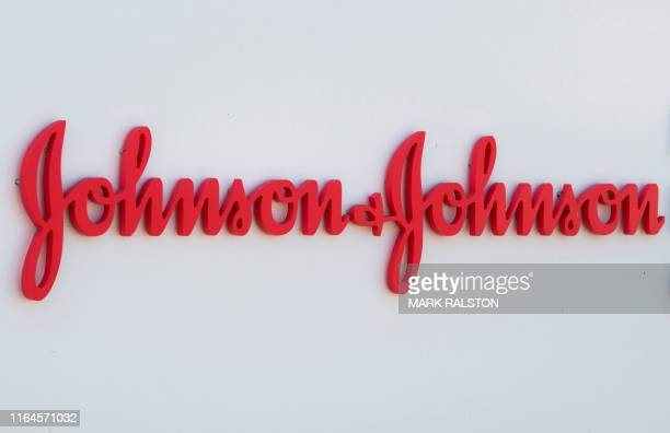 An entry sign to the Johnson & Johnson campus shows their logo in Irvine, California on August 28, 2019. - The US pharmaceutical industry faces tens...